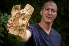 Don Cipollini holding piece of white fringetree affected by emerald ash borer