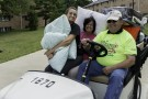 Golf cart with pillows and people